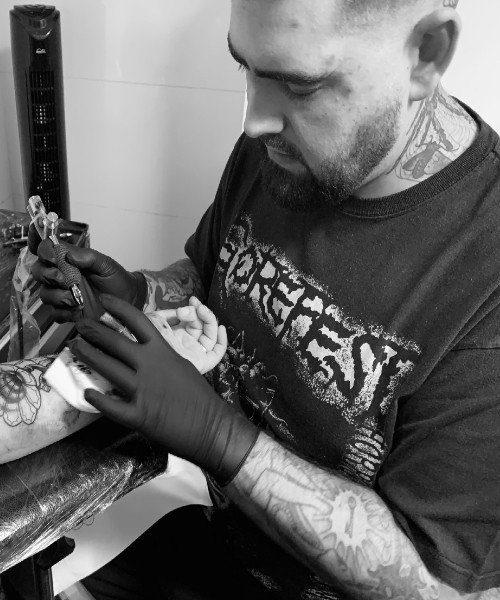 Tattoo artist - lee